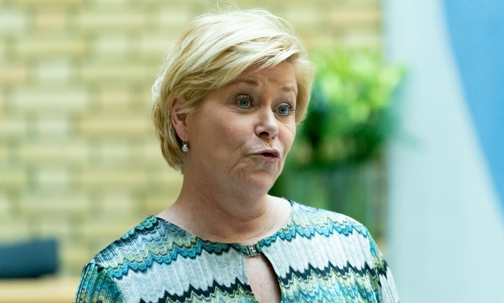 Frp-leder Siv Jensen sier partiet er åpne for å vurdere forlengelse av coronaloven. Foto: Fredrik Hagen / NTB scanpix