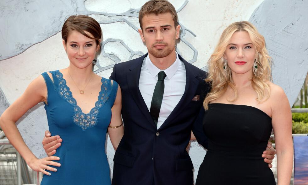 SYKDOM: Shailene Woodley (t.v.) røper i et nytt intervju at hun slet med sykdom i begynnelsen av 20-årene, på den tiden hun spilte inn «Divergent»-filmene. Her med kollegene Theo James og Kate Winslet på «Divergent»-premieren i London i 2014. Foto: NTB scanpix