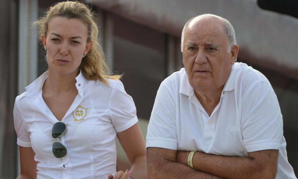 ULTRARIKE: Den spanske forretningsmannen Amancio Ortega (84) har gjort seg styrtrik på klær. Han har indikert at kvinnen til venstre en dag skal overta alt. Foto: NTB Scanpix
