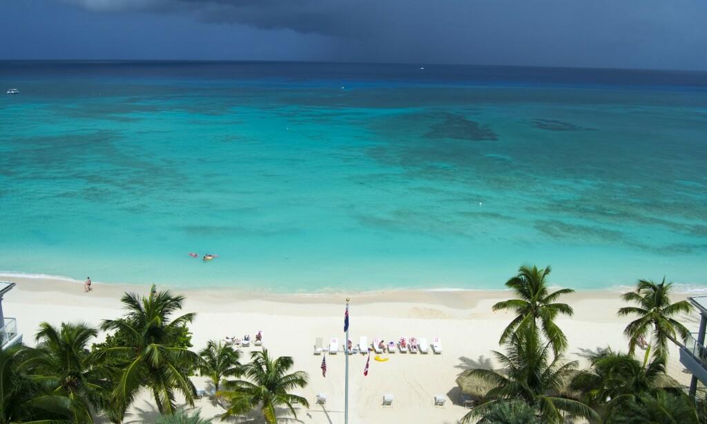 IDYLLISK: Cayman er kjent som et av verdens mange finanssentrum og ligger i Det karibiske hav, ikke langt fra Cuba og Jamaica. Staten defineres som et britisk oversjøisk territorium. Foto: NTB Scanpix