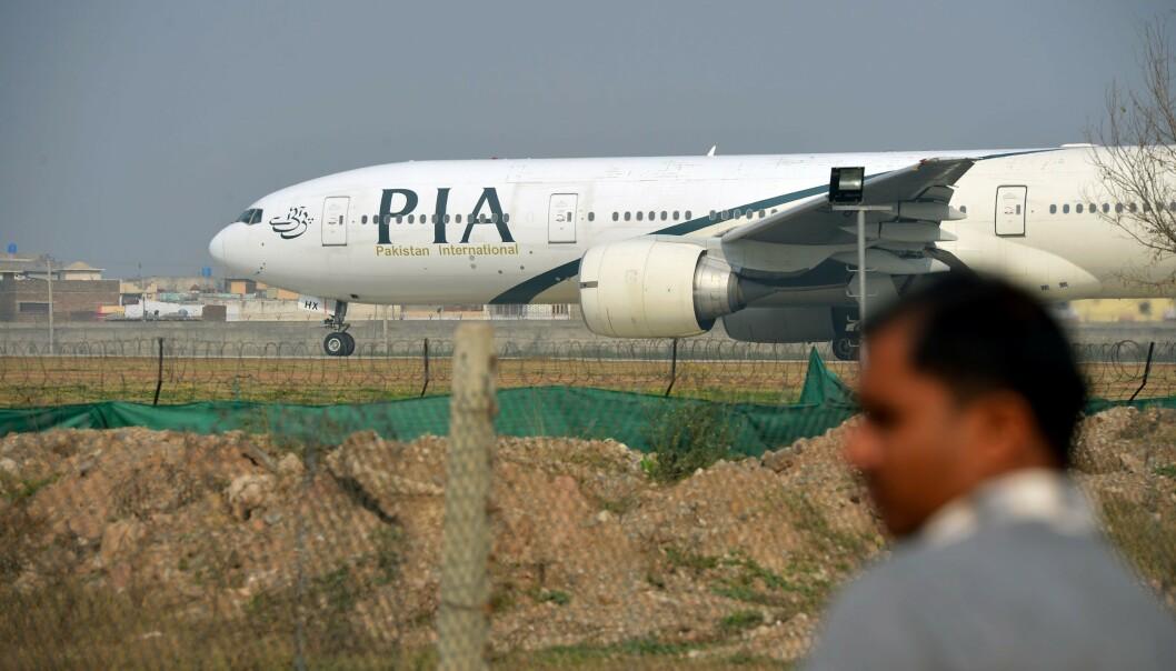 <strong>STYRTET FØR LANDING:</strong> Et fly fra flyselskapet Pakistan International Airlines (PIA) skal ha styrtet kort tid før landing i Karachi i Pakistan fredag. Det er ikke kjent om flyet avbildet er ulykkesflyet. Foto: Farooq NAEEM / AFP / NTB scanpix