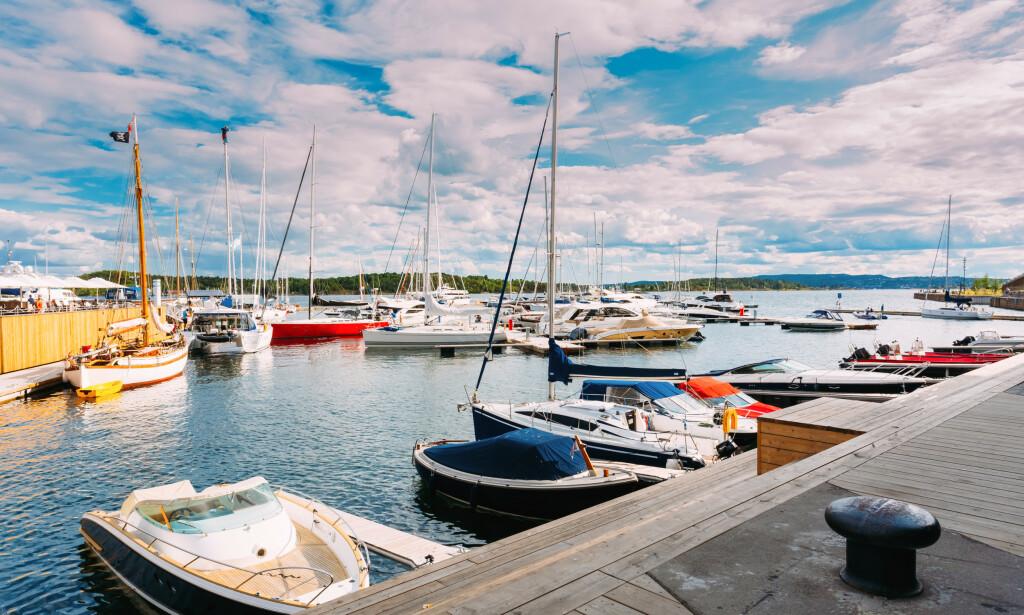 SOMMERIDYLL: Sommer, sol og sjø. Her fra Aker Brygge i Oslo. Foto: Shutterstock
