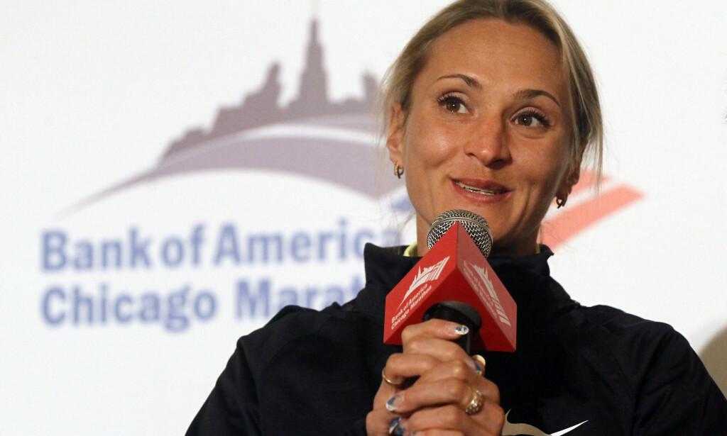 BETALTE OG FORTALTE: Den russiske maratonstjernen Liliya Shobukhova måtte betale millioner til friidrettslederne sine for å få beskyttelse for eget dopingbruk. Så fortalte hun alt om svindelen på tysk TV. Det la grunnlaget for den store rettssaken som starter i dag. FOTO: AP/Charles Rex Arbogast.