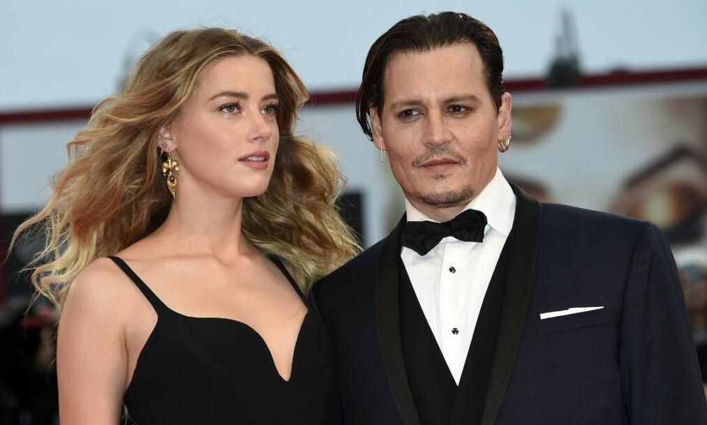 FORBANNA: Johnny Depp hevder at ekskona Amber Heard har vært utro ved å ha trekant med både supermodell Cara Delevingne og Tesla-gründer Elon Musk. Foto: NTB Scanpix