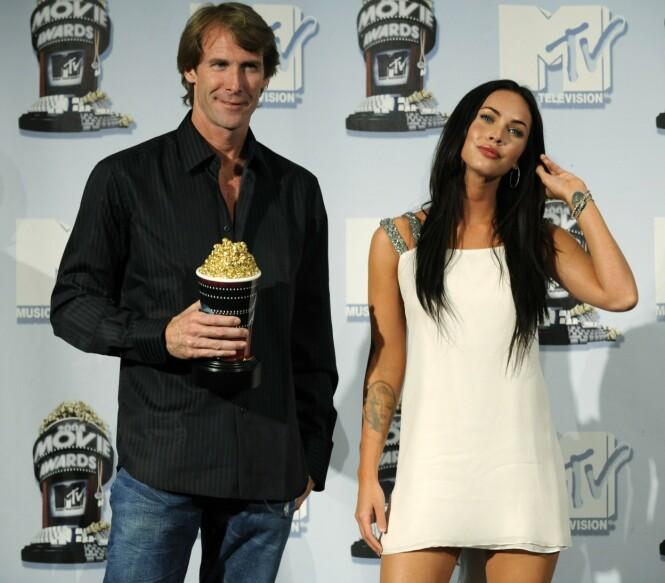 VEKKER OPPSIKT: Intervjuet fra 2009 hvor Megan Fox uttalte seg om sin opplevelse med filmregissør Michael Bay har nå blitt vekket til live igjen. Her er hun avbildet med Michael Bay på MTV Movie Awards i 2008. Foto: AP/ NTB scanpix