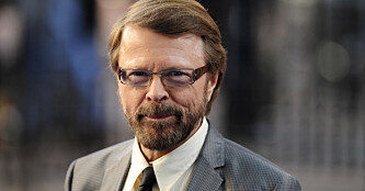 """Bjrn Ulvaeus, former member of Swedish pop group 'ABBA', poses as he arrives for the world premiere of """"Mamma Mia"""" at Leicester Square in London June 30, 2008.  REUTERS/Dylan Martinez     (BRITAIN)"""