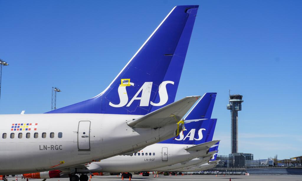 MASSEOPPSIGELSE: Luftfartsselskapet SAS har blitt hardt rammet av coronakrisa. Nå sier de opp tusenvis av ansatte i både Danmark og Norge. Foto: Håkon Mosvold Larsen / NTB Scanpix
