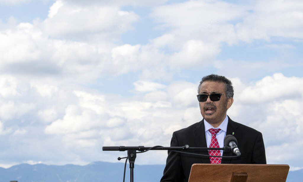 WHO, World Health Organization Director-General, Tedros Adhanom Ghebreyesus, speaks during the relaunch ceremony of the famous fountain 'Le Jet d'Eau', which was postponed due to the coronavirus outbreak, in Geneva, Switzerland, Thursday, June 11, 2020. (Martial Trezzini/Keystone via AP)