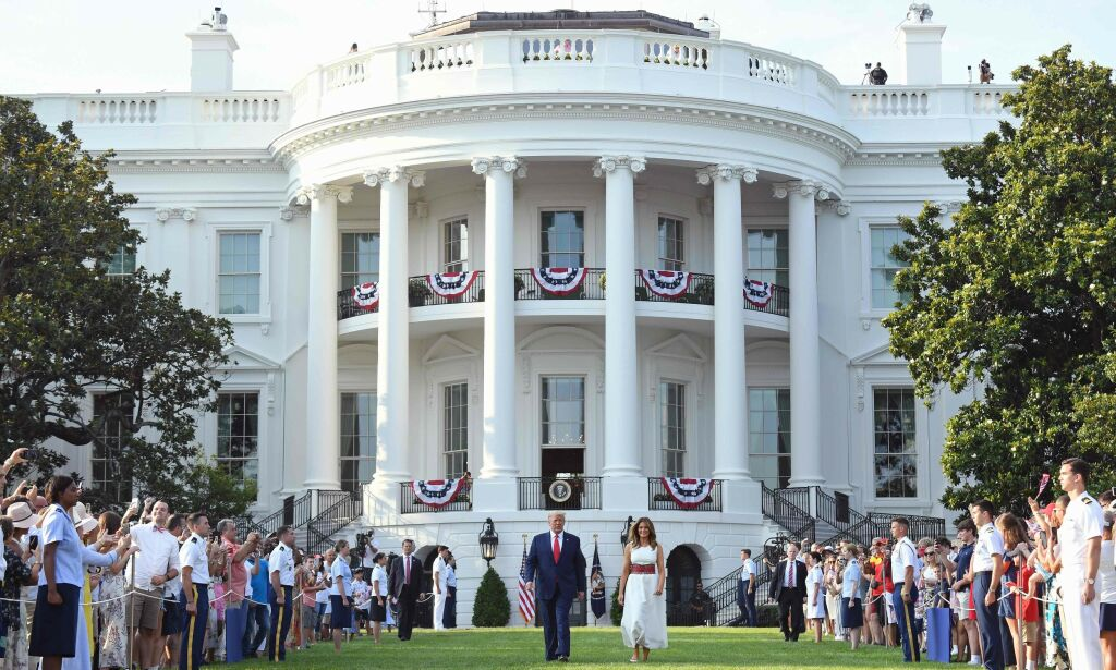 """US President Donald Trump and First Lady Melania Trump arrive for the 2020 """"Salute to America"""" event in honor of Independence Day on the South Lawn of the White House in Washington, DC, July 4, 2020. (Photo by SAUL LOEB / AFP)"""