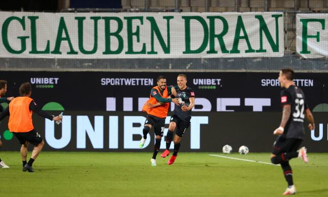 WERDER-JUBEL: Ludwig Augustinsson ga Werder Bremen 2-1 fire minutter på overtid. Kampen endte 2-2. Foto: NTB scanpix