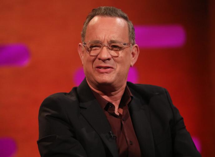 <strong>- SMERTER:</strong> Tom Hanks forteller at han og kona reagerte helt forskjellig på coronaviruset. Mens hun mistet lukt- og smakssans, hadde han smerter i kroppen. Foto: NTB Scanpix