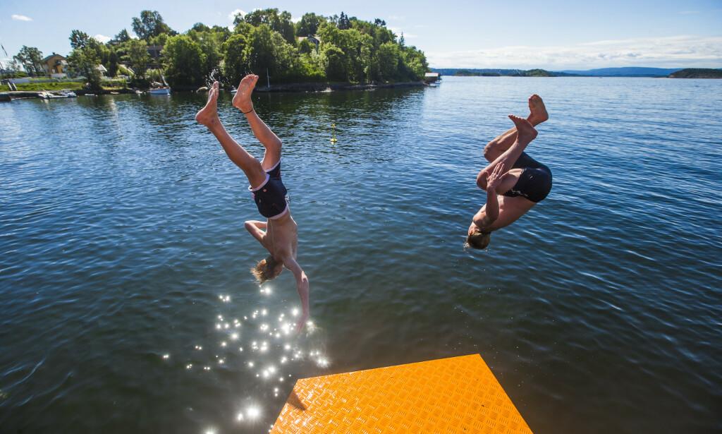 BADEVÆR: Du er ikke garantert sol og varme, selv om det er sommer. Foto: Trond Reidar Teigen / NTB scanpix