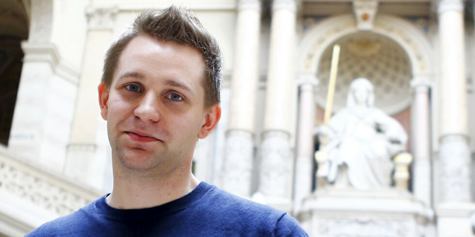 Austrian data activist Max Schrems stands in the courthouse after his trial against Facebook in Vienna April 9, 2015. Schrems, who had closed the list of plaintiffs after 25,000 people joined a campaign alleging that the social media giant had violated users' privacy, is claiming damages of 500 euros per user for alleged data violations by Facebook, including by aiding the U.S. National Security Agency in running its PRISM programme, which mined the personal data of users of Facebook and other web services.   REUTERS/Leonhard Foeger