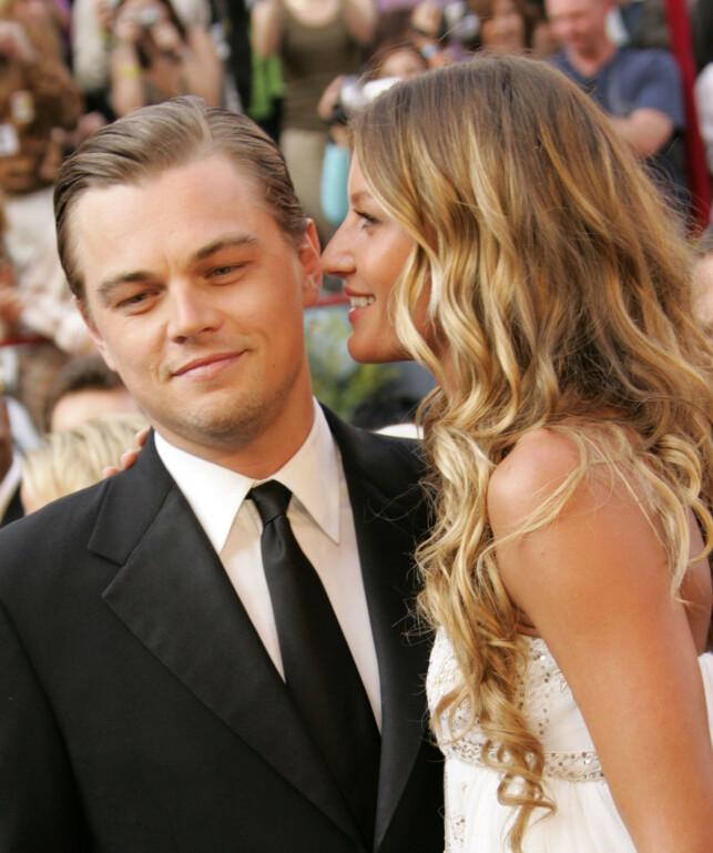 SJOKKERTE: Da DiCaprio tok med Bündchen på Oscar-utdelingen i 2005, gikk blitslampene til fotografene av uten stopp. Samme år gikk de for øvrig fra hverandre. Foto: NTB Scanpix