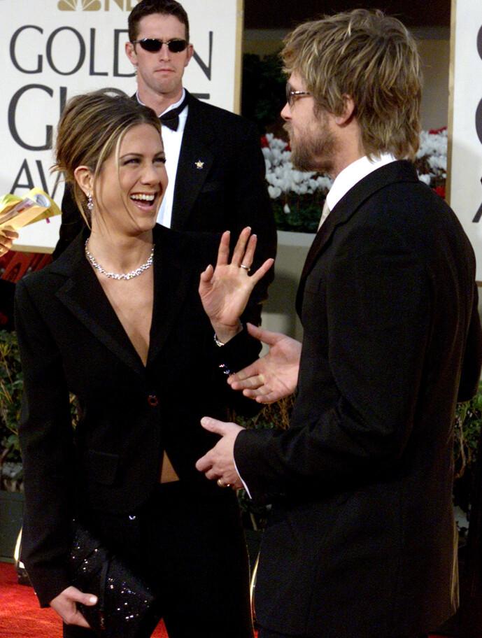 MATCHET: Duoen gjorde som regel fint lite for å skjule sine følelser for hverandre på den røde løperen. Her på Golden Globe-utdelingen for 18 år siden. Foto: NTB Scanpix