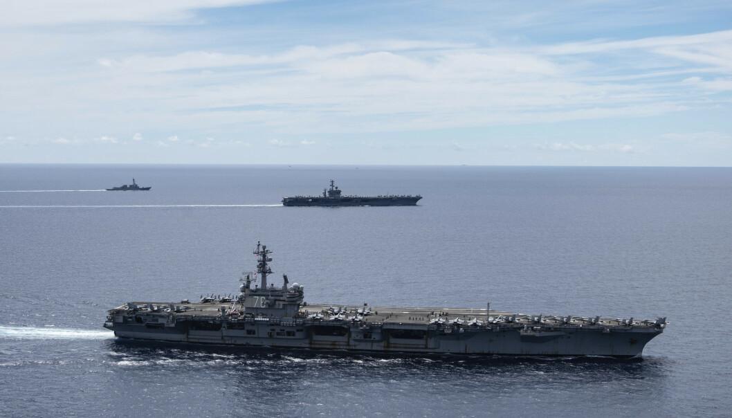 VISTE MUSKLER: Amerikanske hangaskip avbildet i Sør-Kinahavet mandag 6. juli. Den militære tilstedeværelsen kom som et svar på Kinas varslede militærøvelse i havområdet. Foto: Jason Tarleton / U.S. Navy / AP / NTB scanpix