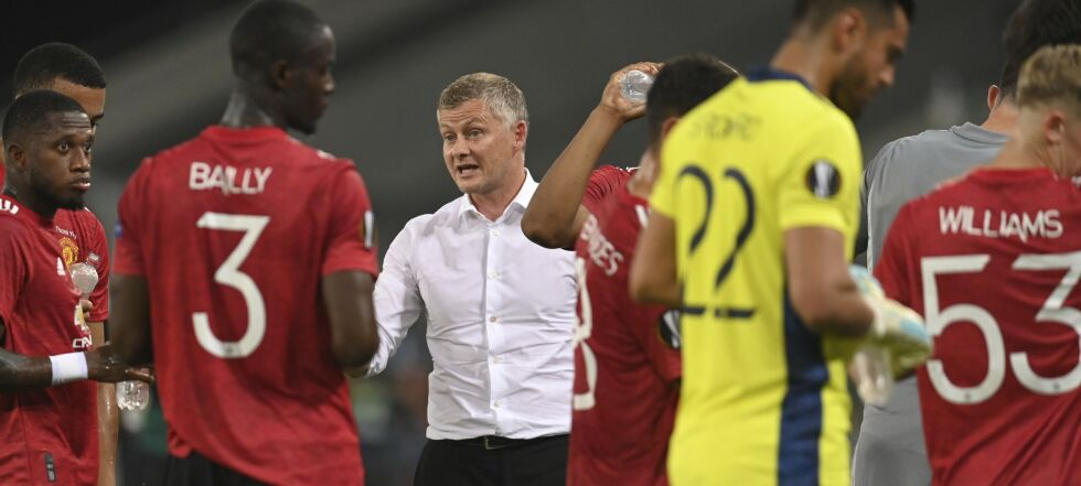 Manchester United's manager Ole Gunnar Solskjaer gives directions to his players during the Europa League quarter-final soccer match between Manchester United and Copenhagen at the Rhein Energie Stadium in Cologne, Germany, Monday, Aug. 10, 2020. (Sascha Steinbach/EPA via AP)
