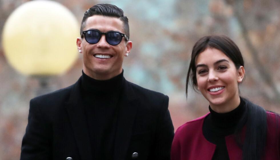 <strong>NY RYKTEFLOM:</strong> Flere av stjerneparets fans er overbeviste om at Cristiano Ronaldo og kjæresten Georgina Rodríguez har forlovet seg. Foto: NTB Scanpix