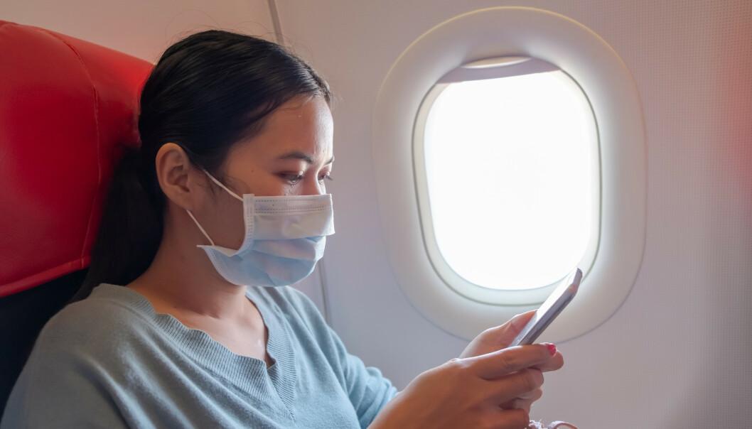 <strong>SMITTEFARE:</strong> Det kan være lurt å velge vindussete for å begrense faren for smitte på fly. Foto: Shutterstock/NTB Scanpix