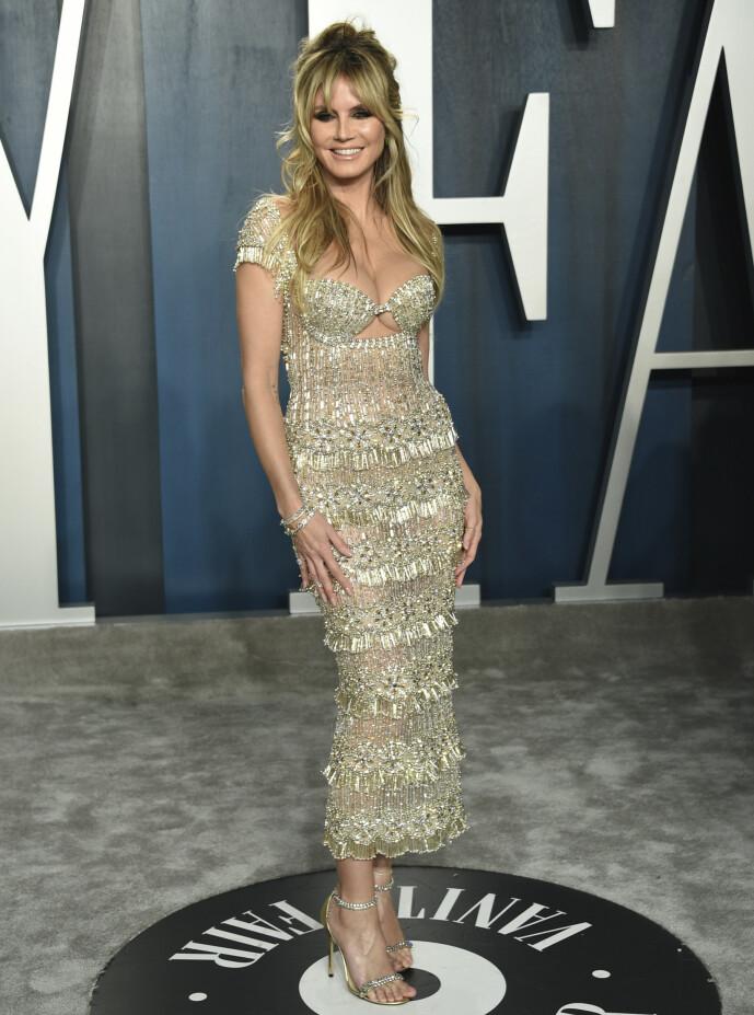 <strong>MANGE JERN I ILDEN:</strong> De siste årene har Heidi Klum markert seg i flere ulike TV-produksjoner. Her på Vanity Fairs Oscar-fest i februar i år. Foto: AP/ NTB scanpix