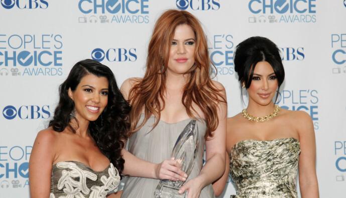 <strong>FAVORITTER:</strong> Opp gjennom årene har fansen latt seg bergta av Kourtney, Khloé og Kim Kardashian. Nå varsler sistnevnte at TV-eventyret er over. Her fotografert i 2011. Foto: NTB Scanpix