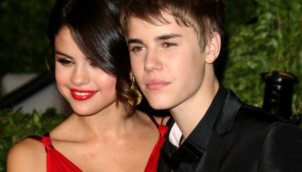 <strong>ÅPNER OPP:</strong> I forbindelse med en ny lansering, forteller popstjernen Selena Gomez nå om hvordan ekskjærestene hennes oppfatter henne. Her fotografert med eksen Justin Bieber i 2011. Foto: NTB Scanpix