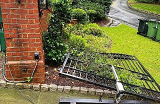 Image: Rev av elektrisk port for å rekke jobb